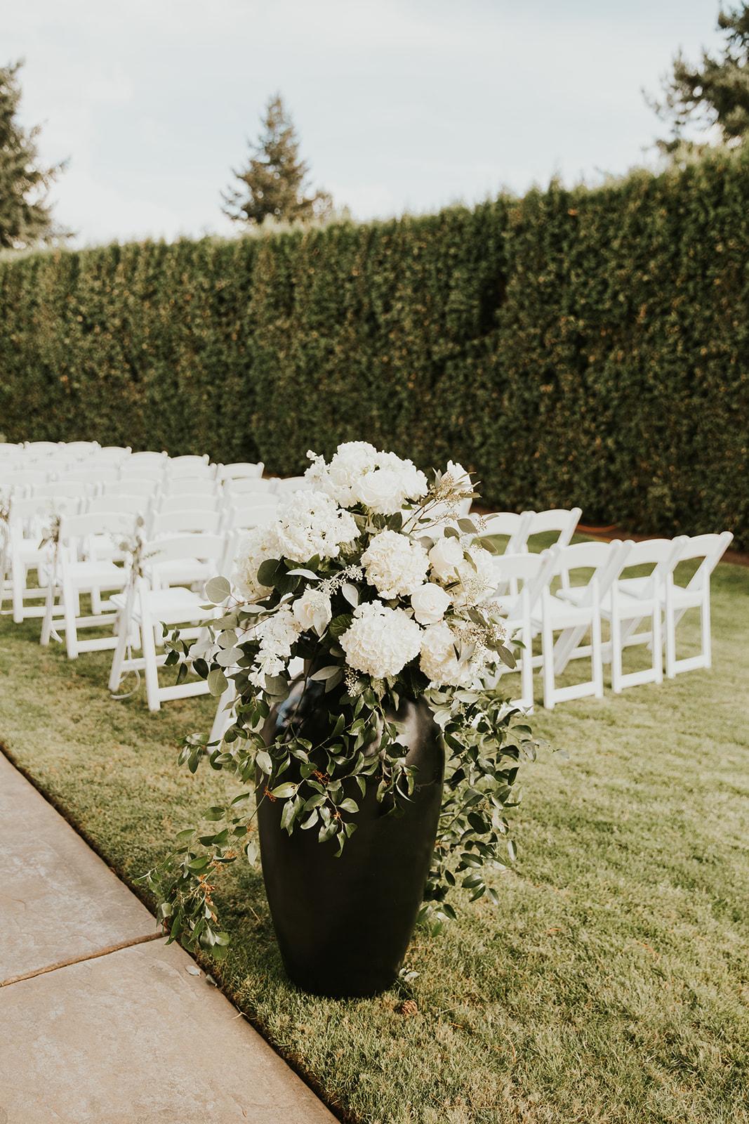 hydrangea, roses, stock flowers, southern smilax, smilax, urn arrangements, ceremony decor, classic wedding flowers
