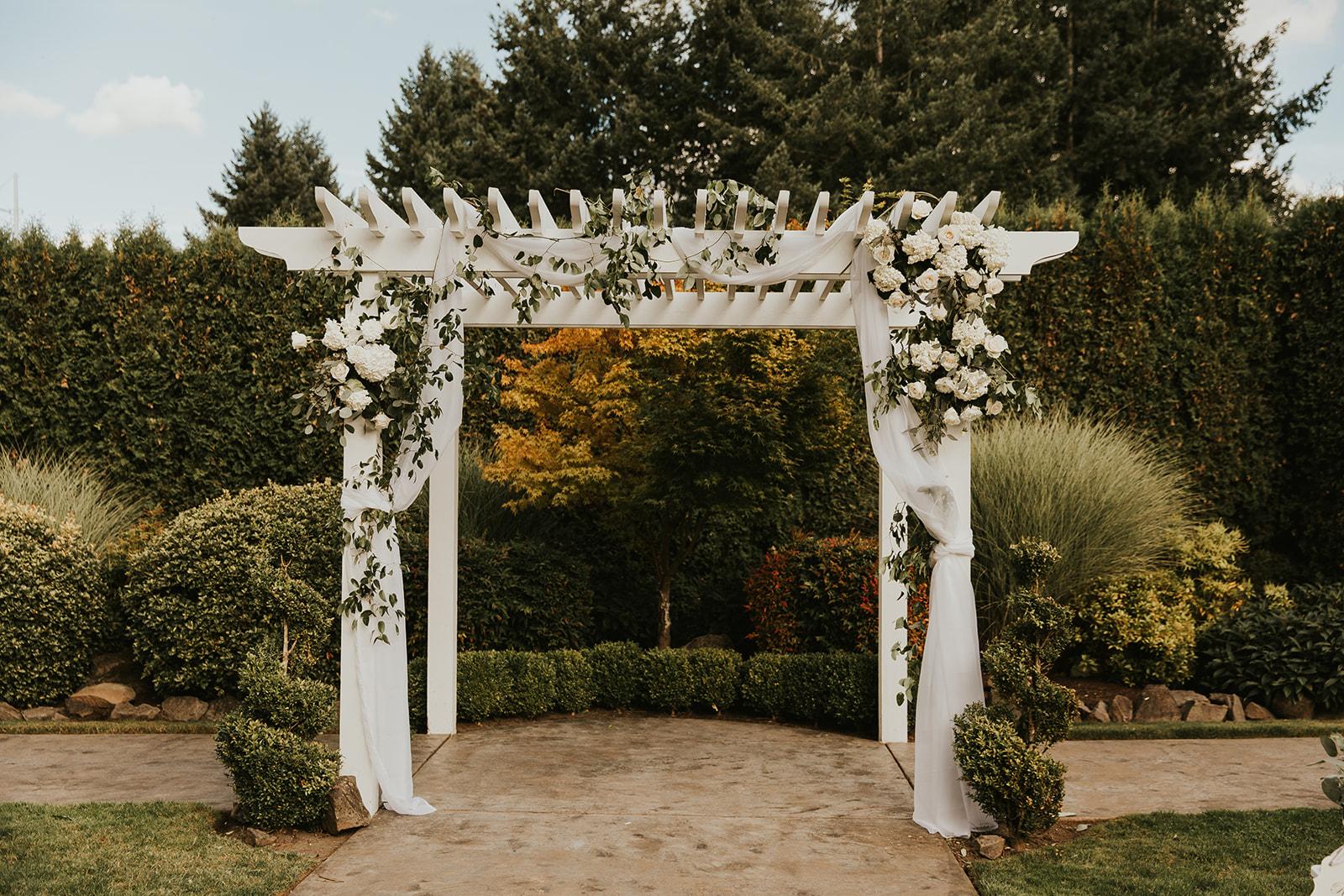wedding arbor, classic wedding arbor, arbor decor, arch decor, floral installation, ceremony flowers, white and greenery florals, wedding flowers