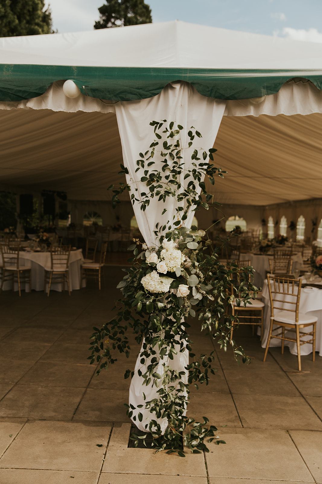 wedding tent entrance, wedding tent decor, wedding tent flowers, southern smilax wedding tent, wedding reception decor, reception entrance, reception tent, white and greenery wedding flowers