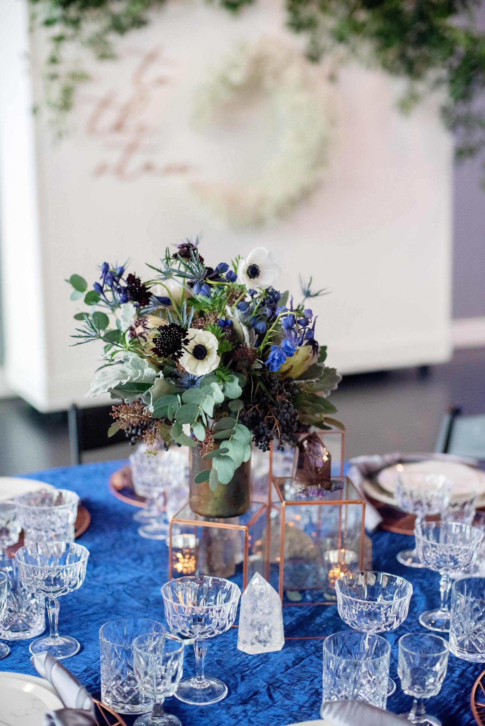 white and black anemone, white anemone, celestial wedding, tablescape, wedding ideas, wedding flowers, altar flowers, blue wedding