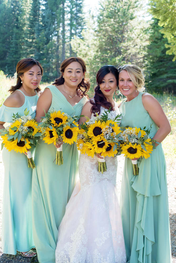 bridal party flowers, bridal party, bridesmaids, bridesmaids dresses, sea foam green bridesmaid dresses, mint bridesmaid dresses, sunflower bouquets, sunflower bridesmaid bouquets
